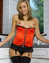 Melanie in red satin basque with black stockings